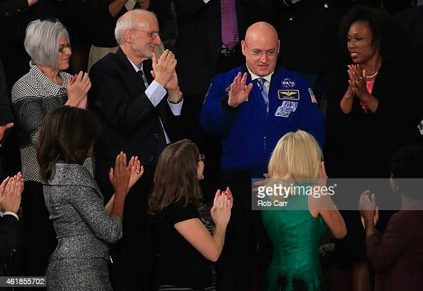 Astronaut Scott Kelly waves after being recognized by US President Barack Obama during the State of the Union speech in the House chamber of the US...