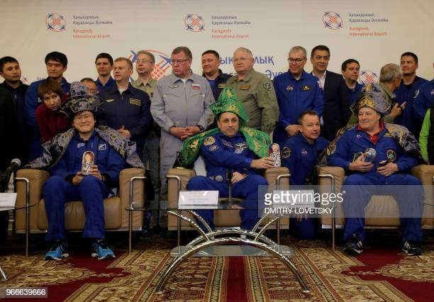 US astronaut Scott Tingle Russian cosmonaut Anton Shkaplerov and Japanese astronaut Norishige Kanai pose after the landing of the Russian Soyuz MS07...