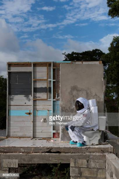 Astronaut Seated On Toilet In A Storm Damaged House