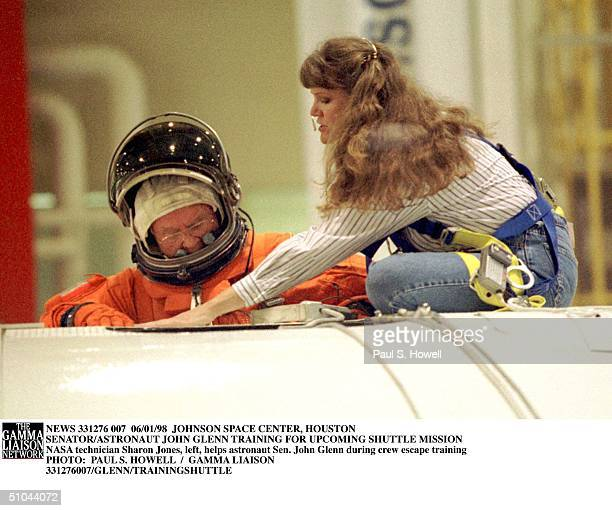 Astronaut Sen. John Glenn Climbs Out Of A Space Shuttle Mock Up With The Help Of Nasa Technician Sharon Jones During Crew Escape Training Monday,...