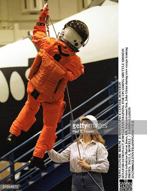 Astronaut Sen. John Glenn, Left, Is Lowered To The Floor By Nasa Technician Sharon Jones During Crew Escape Training Monday, June 1 At Nasa's Johnson...
