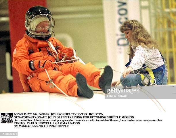 Astronaut Sen. John Glenn Sits Atop A Space Shuttle Mock Up With Technician Sharon Jones During Crew Escape Exercises Monday, June 1 At Nasa's...