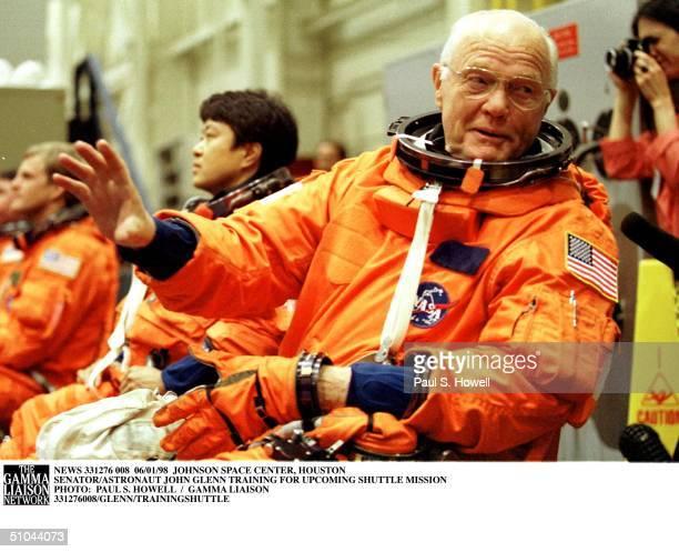 Astronaut Sen. John Glenn Talks During A Break In Crew Escape Training Monday, June 1 At Nasa's Johnson Space Center In Houston. (Gamma Liaison
