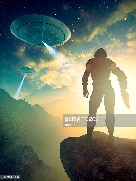 Astronaut soldier on distant planet discovering UFO