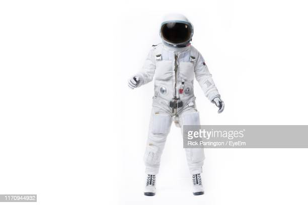 astronaut standing against white background - space helmet stock pictures, royalty-free photos & images