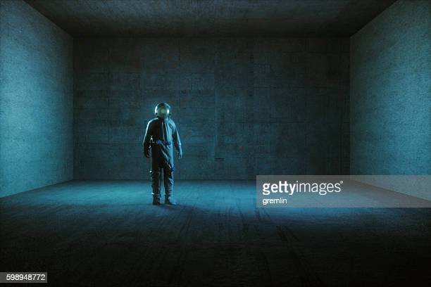 Astronaut standing in empty spaceship room