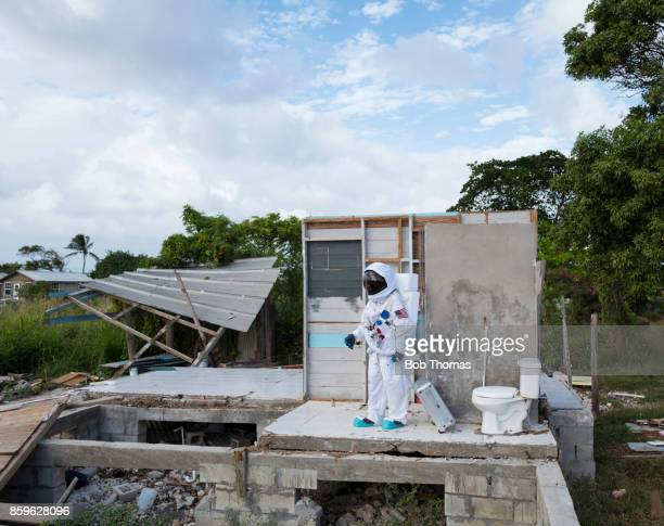 Astronaut Standing In Storm Damaged House