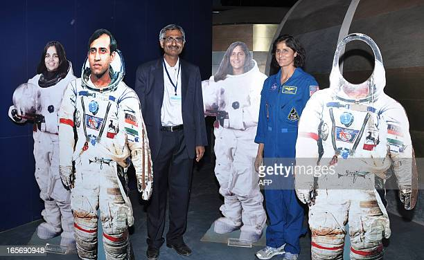 US astronaut Sunita Williams and Gujarat Science City's Executive director Dilip Gadhavi pose with the life sized cutouts of Indian astronauts Late...