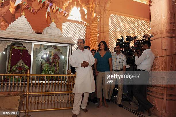 US astronaut Sunita Williams arrives at the Dola Mataji Temple to offer prayers at Jhulasan Village where she was born some 50 kms from Ahmedabad on...