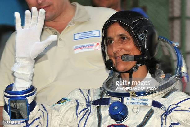 Astronaut Sunita Williams of the US gestures before boarding the Soyuz TMA05M spacecraft at the Russianleased Baikonur cosmodrome on July 15 2012...