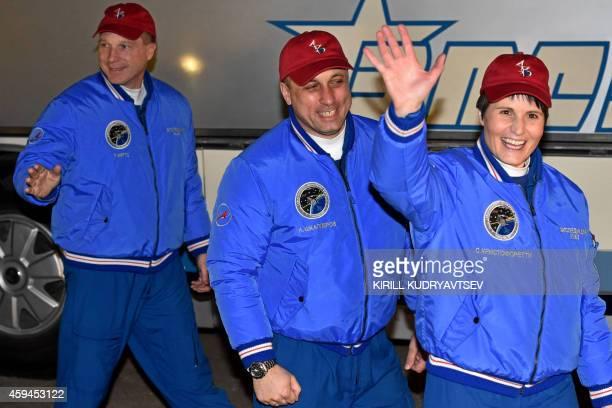 US astronaut Terry Virts Russian cosmonaut Anton Shkaplerov and European Space Agency's Italian astronaut Samantha Cristoforetti walk from their...