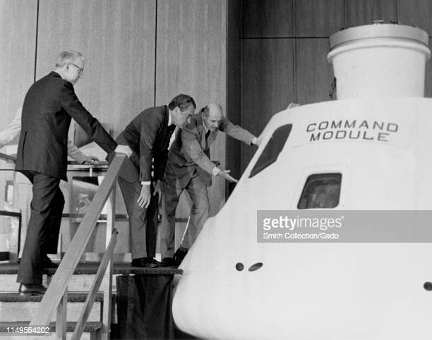 Astronaut Thomas P Stafford and Dr James C Fletcher provide a briefing on the Apollo Command Module to President Richard M Nixon April 1974 Image...
