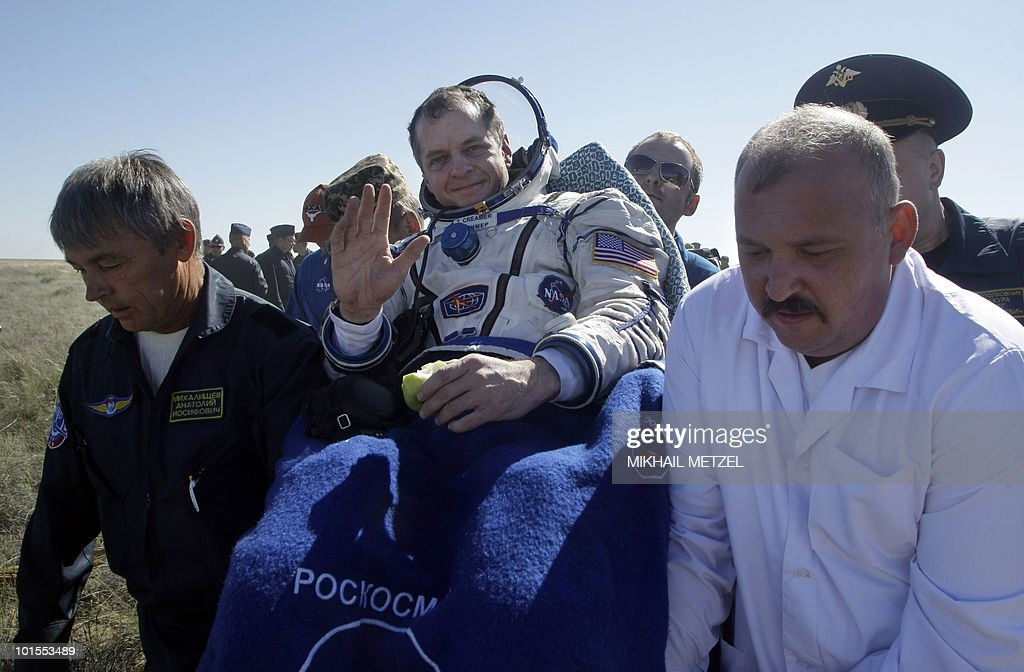 US astronaut Timothy Creamer is carried away after the landing of the Russian Soyuz TMA-17 space capsule about 150 km (80 miles) south-east of the Kazakh town of Dzhezkazgan on June 2, 2010. The Soyuz capsule, which carried the three astronauts safely returned to Earth after a half-year stint on the international space station, with a landing in the Kazakh steppe.