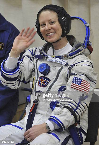 US astronaut Tracy Caldwell Dyson waves while getting into her space suit at Kazakhstan's Russianleased Baikonur cosmodrome on April 2 2010 for...