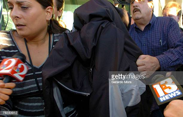 NASA astronaut US Navy Captain Lisa Nowak covered with a jacket leaves the Orange County Florida Jail with a member of the Orlando Community Justice...