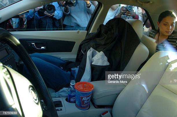 NASA astronaut US Navy Captain Lisa Nowak covered with a jacket sits in a car with a member of the Orlando Community Justice Programs Jeanice Chevere...