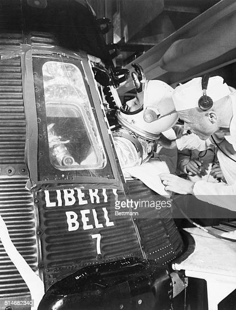 Astronaut Virgil Grissomis assisted into the space capsule Liberty Bell 7 for the second American suborbital trip into space