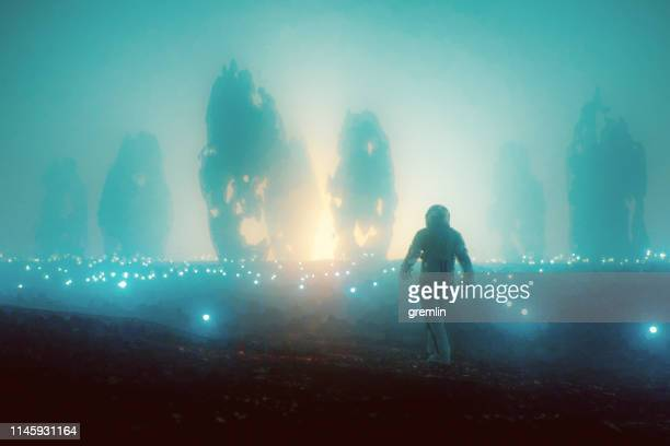 astronaut walking distant exo planet - ancient civilization stock pictures, royalty-free photos & images