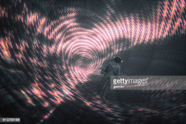 astronaut walking in mysterious alien spaceship tunnel - time travel stock pictures, royalty-free photos & images