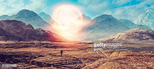 astronaut walking on alien planet, ufo portal - military invasion stock pictures, royalty-free photos & images