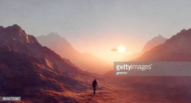 astronaut walking on mars, ufo flying - spaceship stock photos and pictures