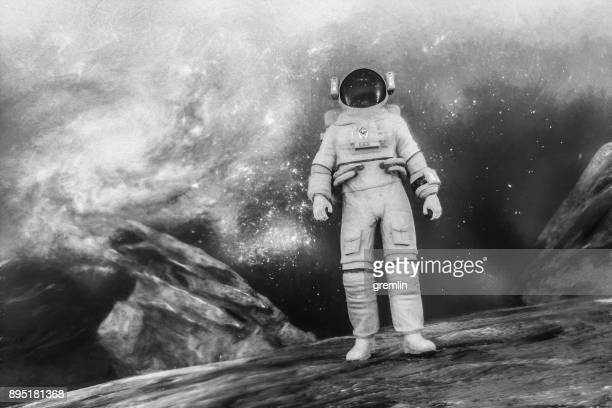 Astronaut walking on planet surface