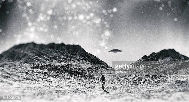Astronaut walking towards UFO