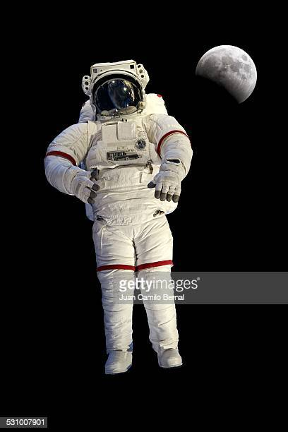 astronaut with the moon in the back - astronaut stock-fotos und bilder
