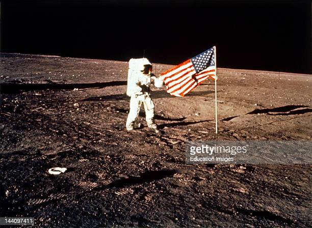 Astronaut With US Flag On Moon