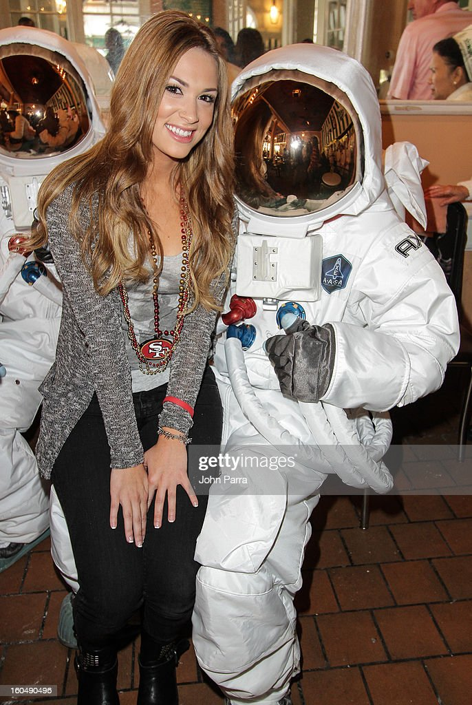 AXE Astronauts (R) and Samantha Rathman invade New Orleans to celebrate the AXE Apollo line products on on February 1, 2013 in New Orleans, Louisiana.