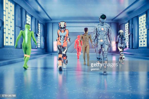 astronauts and space travelers walking in spaceship corridor - spaceship stock photos and pictures