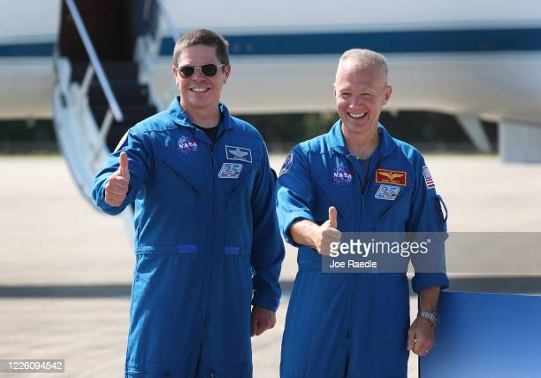 NASA astronauts Bob Behnken and Doug Hurley pose for the media after arriving at the Kennedy Space Center on May 20 2020 in Cape Canaveral Florida...