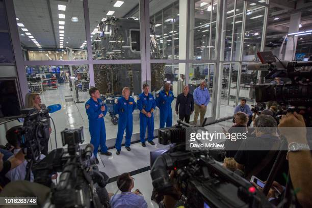 NASA Astronauts Bob Behnken Doug Hurley Mike Hopkins and Victor Glover and Director of Crew Mission Management Benji Reed talk to reporters in front...