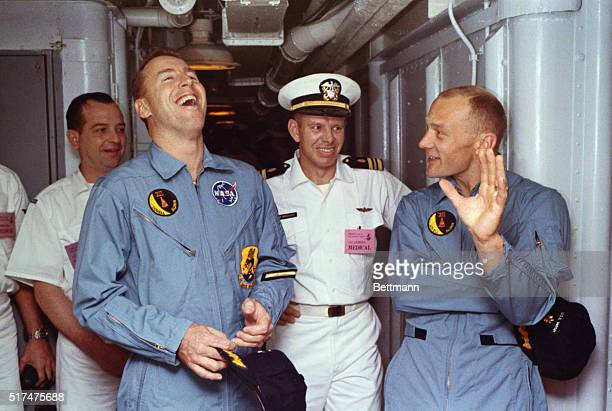 Astronauts Buzz Aldrin and James Lovell are shown with medical team below the deck of the WASP after their successful Gemini12 flight