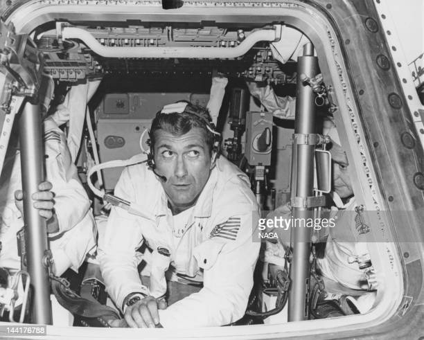 NASA astronauts Charles Conrad Jr Richard Francis Gordon Jr and Alan L Bean during a spacecraft checkout at the North American Rockwell Space...