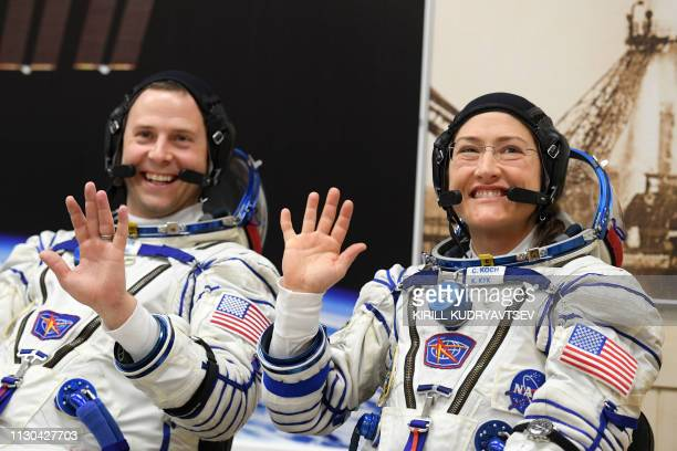 NASA astronauts Christina Hammock Koch and Nick Hague members of the International Space Station expedition 59/60 react shortly before the launch...