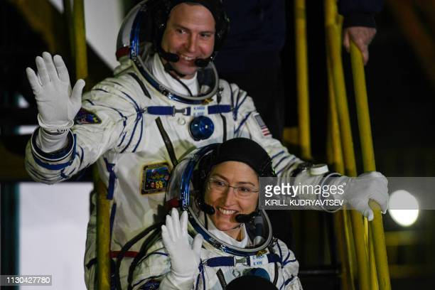 NASA astronauts Christina Hammock Koch and Nick Hague members of the International Space Station expedition 59/60 wave as they board the Soyuz MS12...