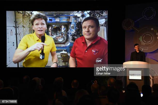 Astronauts Cmdr. Peggy A. Whitson and Col. Jack Fischer are shown live on screen from the International Space Station using a RED Epic Dragon camera...