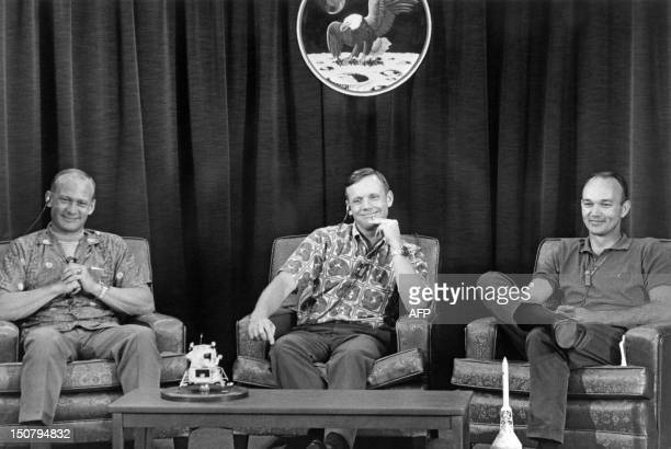US astronauts crew of the Apollo 11 lunar landing mission Edwin Aldrin Neil Armstrong and Michael Collins give a press conference on July 19 1969 AFP...