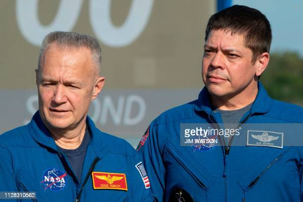 Astronauts Doug Hurley and Bob Behnken assigned to SpaceX Demo2 flight test look on during a press conference at the Kennedy Space Center in Florida...