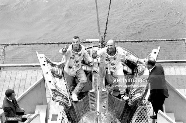 Astronauts Eugene Cernan and Thomas Stafford are welcomed aboard the prime recovery ship the aircraft carrier USS Wasp 1966 Image courtesy National...