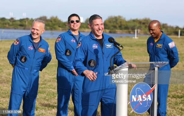 Astronauts, from left, Doug Hurley Bob Behnken, Mike Hopkins and Victor Glover, SpaceX Dragon crew members, share a laugh during a news conference at...