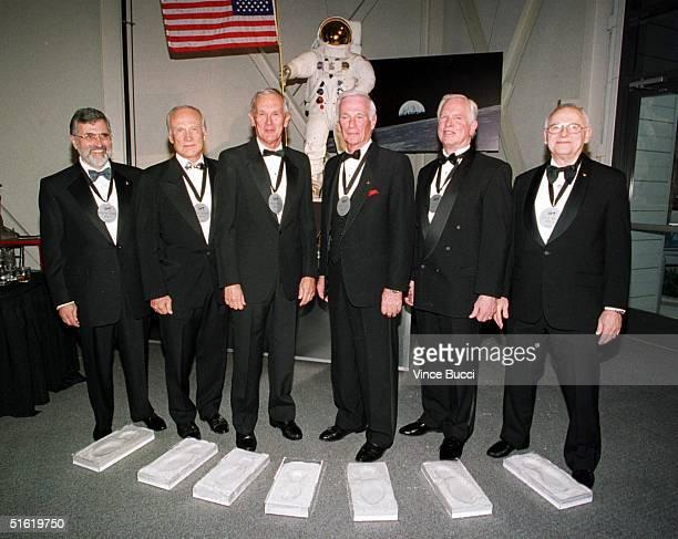 US astronauts from left to right Harrison Schmitt Buzz Aldrin Charles Duke Jr Eugene Cernan David Scott and Alan Bean pose after putting their feet...