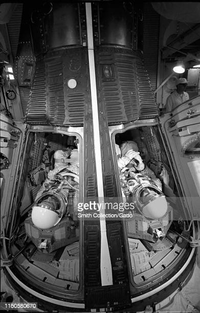 Astronauts James McDivitt and Ed White inside the Gemini spacecraft preparing for a simulated launch at Cape Canaveral Florida May 13 1965 Image...