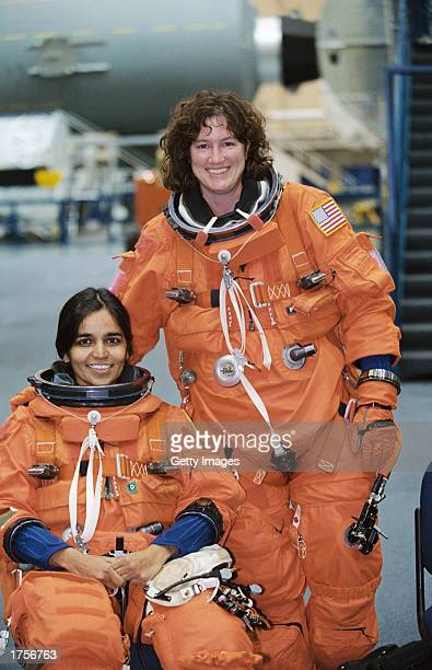 Astronauts Kalpana Chawla and Laurel B Clark both Space Shuttle Columbia STS107 mission specialists are photographed prior to a training session in...