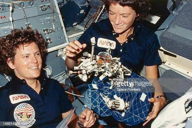 NASA astronauts Kathryn D Sullivan and Sally Ride in the interior of the Challenger space shuttle during the STS41G mission October 1984 They are...