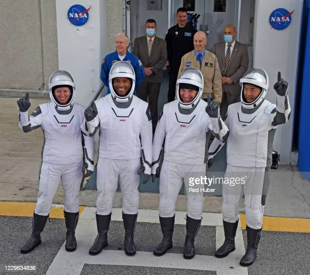 Astronauts, mission specialist Shannon Walker, vehicle pilot Victor Glover, commander Mike Hopkins and mission specialist from the Japan Aerospace...