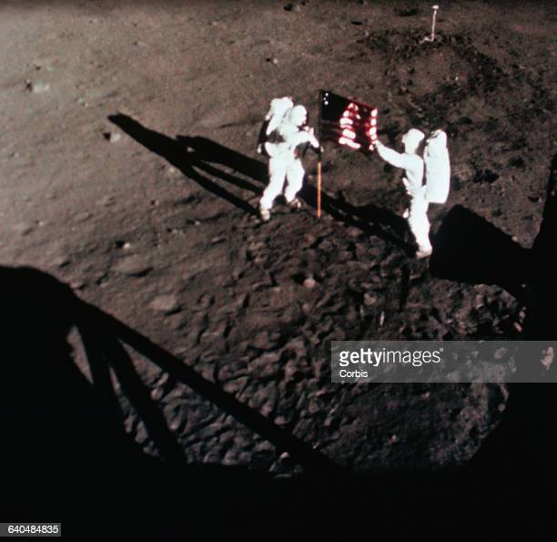 Astronauts Neil Armstrong and Buzz Aldrin place an American flag on the lunar surface | View from 'Eagle' Lunar Module