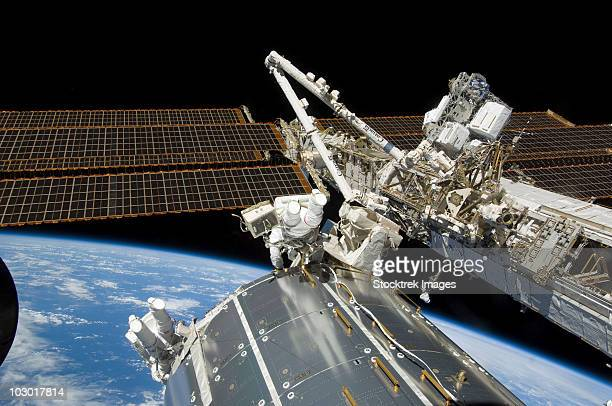 astronauts perform a series of tasks on the exterior of the international space station. - international space station fotografías e imágenes de stock