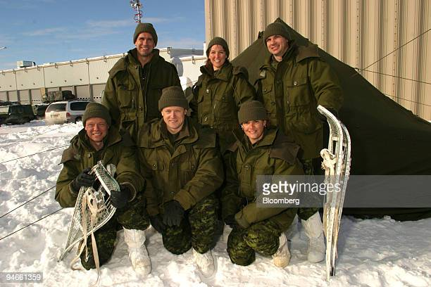 Astronauts pose during winter training in Valcartier Quebec Canada Jan 21 2004 In the front row from left to right are Christer Fuglesang of Sweden...